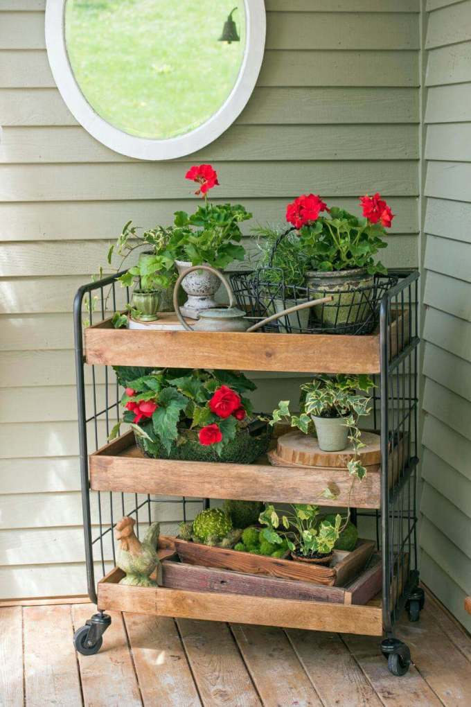 Farmhouse Porch Decorating Ideas - Grocer's Trolley Gardening Display - harpmagazine.com