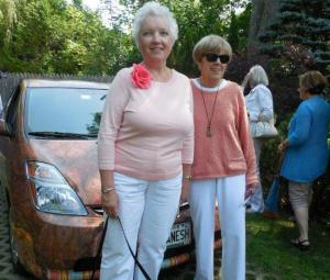 "Suzanne Bushnell and Linda Clement ""match"" the owner's elaborate car design at the Tranquility Garden."