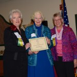 Ann Standridge accepts, on behalf of the Harpswell Garden Club, the New England Region's Excellence in Teamwork Award.   GCFM President Suzanne Bushnell and Awards Chairman Kathleen Marty made the presentation.
