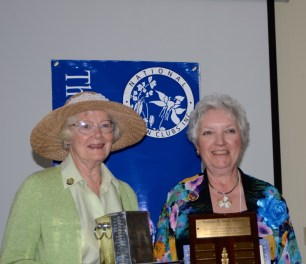 Ann Standridge with GCFM President Suzanne Bushnell and some of the awards our club won