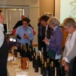 Shoppers at the display of Fiore olive oils and balsamic vinegars at the November meeting.