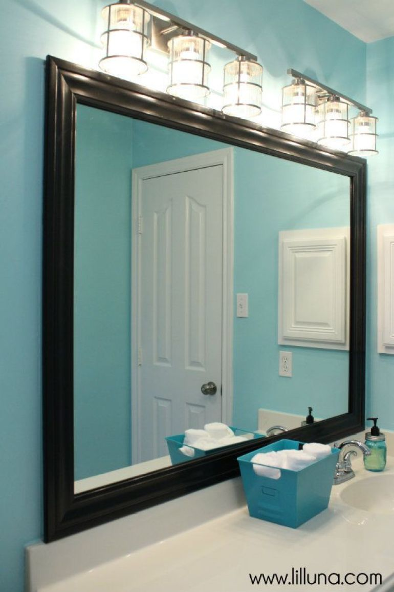 Bathroom Mirror Ideas 8. Black-Framed Mirror in Blue Bathroom - Harptimes.com