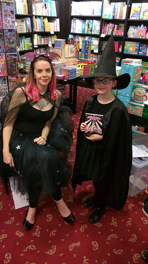 Girl dressed at a witch at Waterstones Hereford's Isadora Moon event with Harriet Muncaster