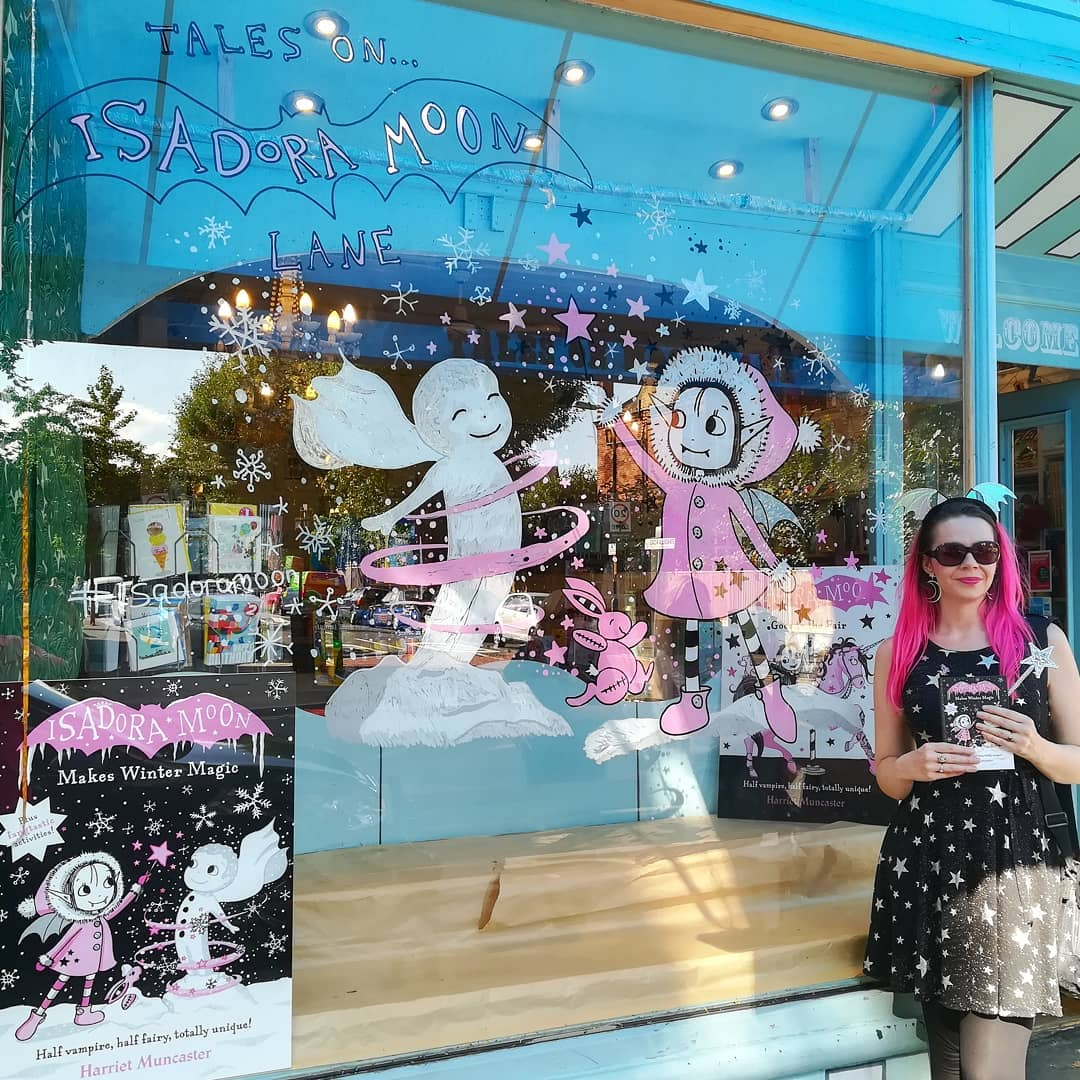 Harriet Muncaster with window display for Tales on Moon Lane