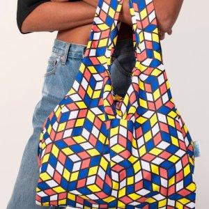 person holding kind bag geometric design