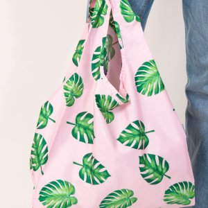 person holding kind bag palm leaves design