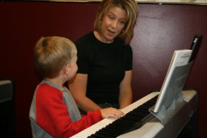 Boy and mother at piano Children's Music Academy Harris Academy of the Arts