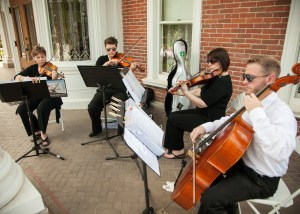 String quartet playing at outdoor wedding