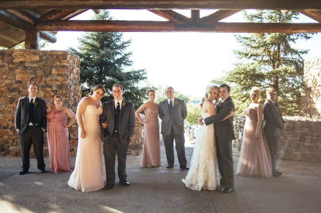 Wedding party with pine trees in the background