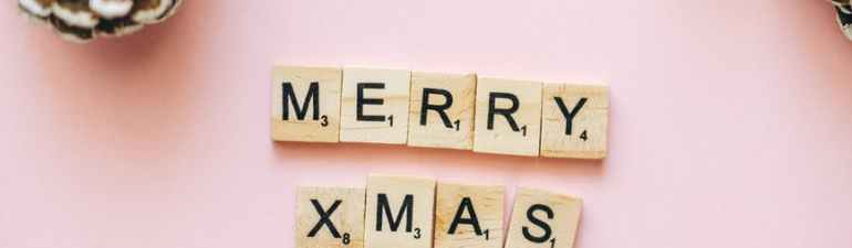 merry xmas text on wooden scrabble tiles