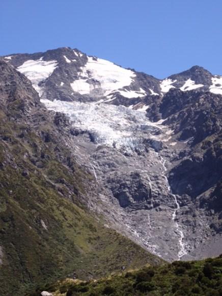 Glacier tumbling down a mountainside.