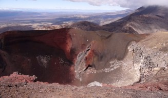 A vivid red and black crater