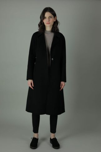 Luxury and warmth, the Cora Cashmere double-face coat is a non-compromiser. Any season, any occasion this iconic coat features 100% cashmere, collar ans waist belt for the perfect silhouette style. Front view.