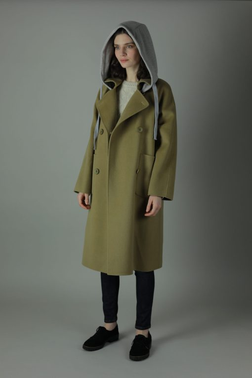 Luxurious practicality in our 100% Cashmere double-face Linda Coat. Hooded and knee length for casual wear, this coat features 100% Cashmere, loose fitting style, two pocket feature and beautiful white soft cotton detachable hood for street style.
