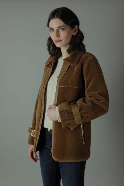 A luxurious new addition for colder weather. The Mala Shearling Coat is made from 100% Shearling with a faux leather base. Wear oversized or fitted depending on your look. This beautifully crafted coat is perfect for layering, it autumnal colours compliment all your wardrobe essentials. Style for any season, any event.