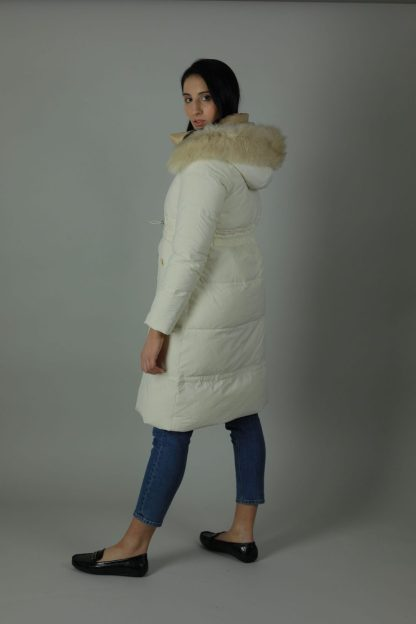The Charlie Down Coat is perfect for the cooling weather. The Charlie is a high shine beautiful Down filled Nylon coat which features an ample hood and a detachable fur trim for style. The Charlie has a rich white exterior, deep cream contrasting interior, white and silver buttons and zip, two front exterior patch pockets and a interior breast pocket. Side view.
