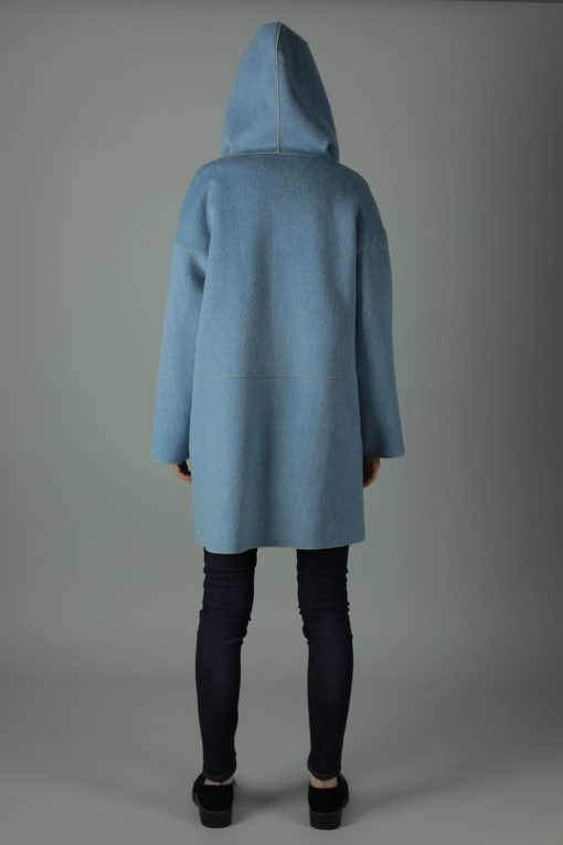Luxury in The Cassie Cashmere Coat. Thigh length for all round wear, this coat features 100% soft Cashmere, loose fitting style, two front patch pockets and beautiful white soft cashmere interior for inside out look.