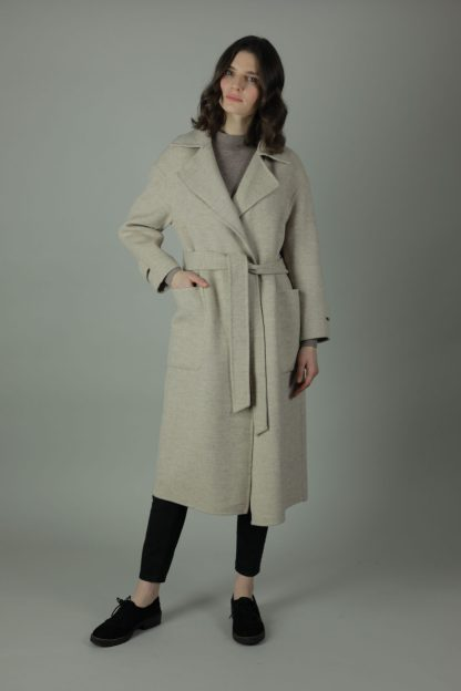 The Andi Cashmere Coat is sheer luxury, warmth and comfort. Styled with a tie waist belt, 100% cashmere and an oversized fit you can wear any year, any season. Front view.