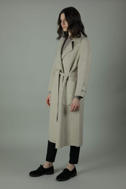 The Andi Cashmere Coat is sheer luxury, warmth and comfort. Styled with a tie waist belt, 100% cashmere and an oversized fit you can wear any year, any season. Side view.