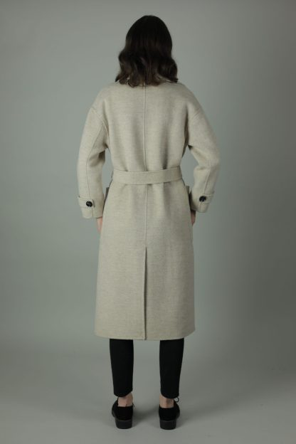 The Andi Cashmere Coat is sheer luxury, warmth and comfort. Styled with a tie waist belt, 100% cashmere and an oversized fit you can wear any year, any season. Back view.
