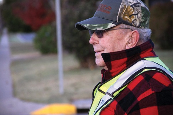 Wes Schmidt started volunteering as a crossing guard 13 years ago and now is helping children of children he helped cross the street years ago.