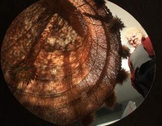 Marjorie Shoemaker's reflection is cast in a round mirror lying on the floor under a giant replica of the Liberty Bell made mostly from wheat; it was displayed at the Smithsonian in Washington, D.C., during the bicentennial. The mirror is directly under the bell, so people can see what the inside of the bell looks like. Shoemaker is director of the Mennonite Heritage and Agricultural Museum in Goessel, where the replica Liberty Bell is on display. Wendy Nugent / The Edge