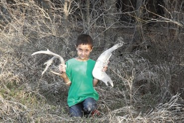 Jacob Friesen holds up his treasures collected while exploring with his grandfather. Steve Gilliland / Exploring Kansas Outdoors