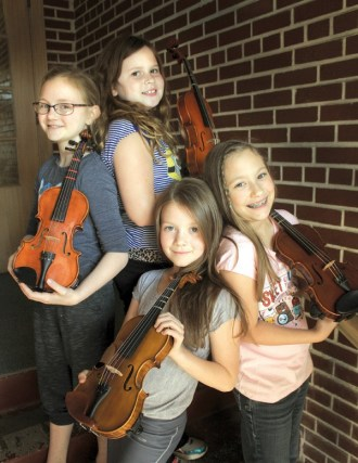 From left in back are Adah Hodge and Lily Schloneger and in front, Natalie Neufeld and Haniah Duerksen, all Suzuki students. Photo by Wendy Nugent