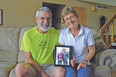 Keith and Judy Harder hold a photo taken during their 310-mile walk along the Camino de Santiago last April and May. The couple spent 27 days walking across Spain along the ancient pilgrimage route to Santiago. Janae Rempel / Free Press
