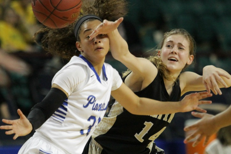Kyndal Bacon (right) battles with a Leavenworth defender Thursday evening at the Topeka ExpoCentre in the class 5A state tournament. Bacon scored a team-high nine points in the 42-40 loss. Photo by Clint Harden