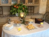 The dessert table before the guests arrived with more breads.