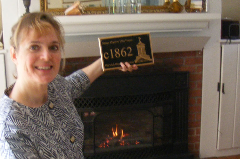 Sara Chase with 1835 plaque