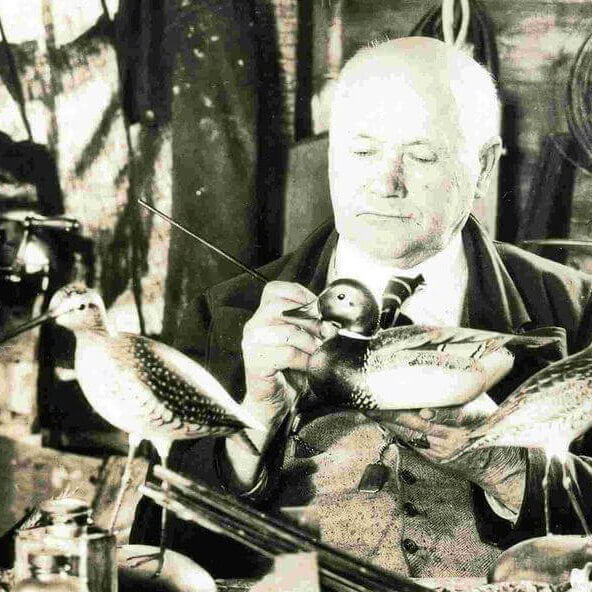 Edward Crowell painting a decoy