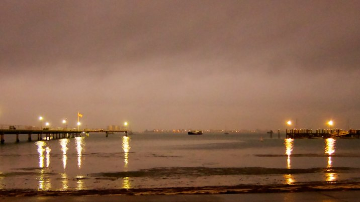 A storm over Boca Ciega bay at night from Gulfport beach.