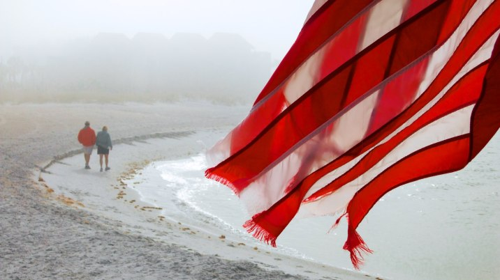 The elements work to erode everything along the coast; this wind-battered flag holds onto some color.