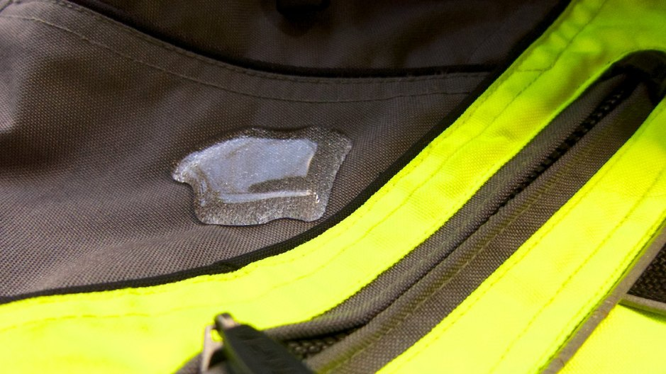 Testing the water repellency of Atsko Silicone Water-Guard on my motorcycle jacket with excellent results.
