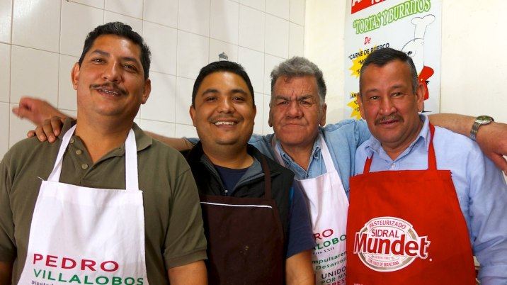 These happy men cook me lunch. They tease the frowny guy for being too friendly with men. I just smile.