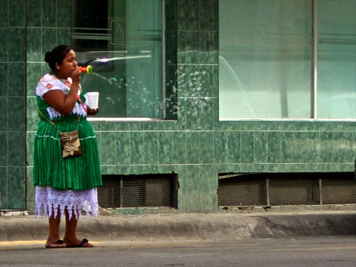 I see this senorita blowing bubbles from across the plaza and think of my mom. She's always blowing bubbles.