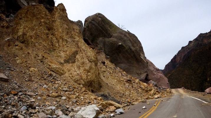 How does a rock the size of a house fall into a road?