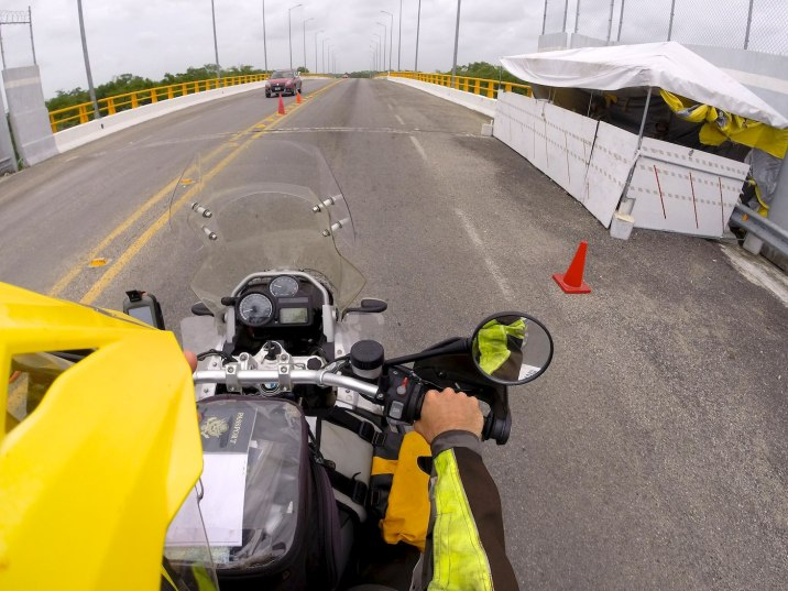 Go by the checkpoint and cross the bridge into Belize.