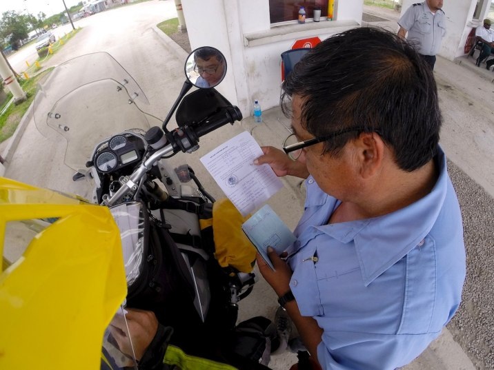 The attendant will inspect the documents and compare the VIN on the bike to the paperwork.