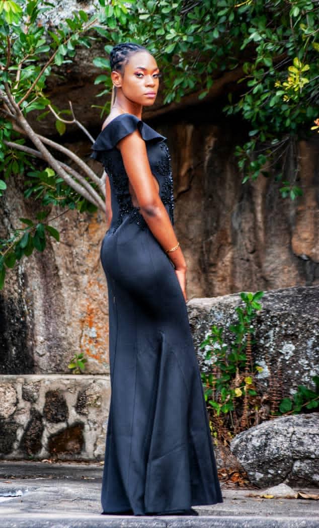 Nyasha Chidimu in a long black dress