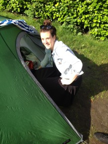 Jess checking out her spot in the tent