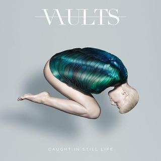 "News Added Nov 20, 2016 Vaults have announced their long-awaited debut record ""Caught In Still Life."" Hailing from Hertfordshire and London, U.K., Vaults are a mysterious, downbeat, self-described ""introspective electronica"" trio, combining ethereal strings with pulsating trip-hop-esque beats and illustrative lyrics. Made up of vocalist and lyricist Blythe, producer Ben, and instrumentalist Barney, Vaults' gradual […]"