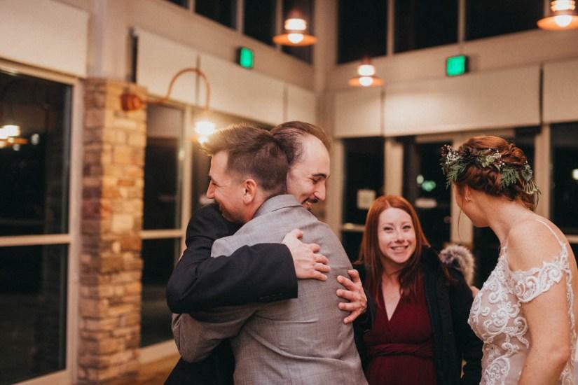 Groom hugging guest at wedding Orange County Wedding Photography