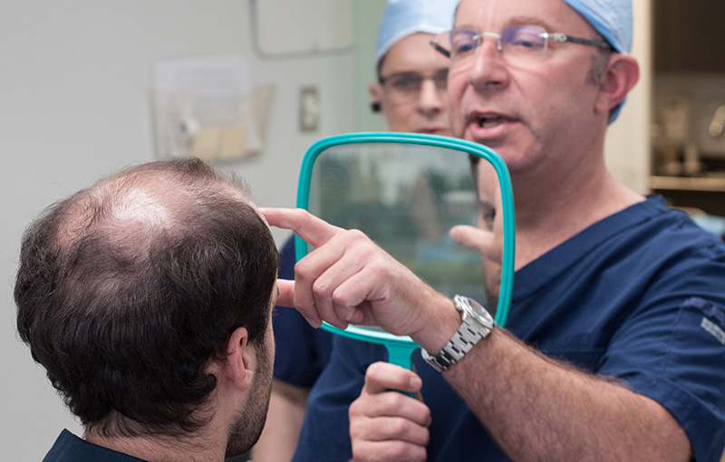 Toronto hair transplant surgeon consulting with patient