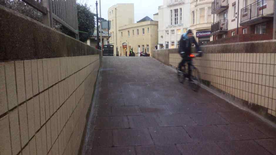 A cyclist using the no-cycling underpass on Hastings seafront.