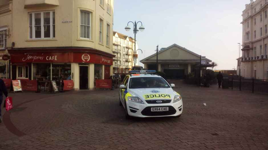 Police sitting in a car in the town centre.