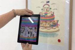 Holding an iPad up to an illustration in a frame on the wall and seeing it come to life!