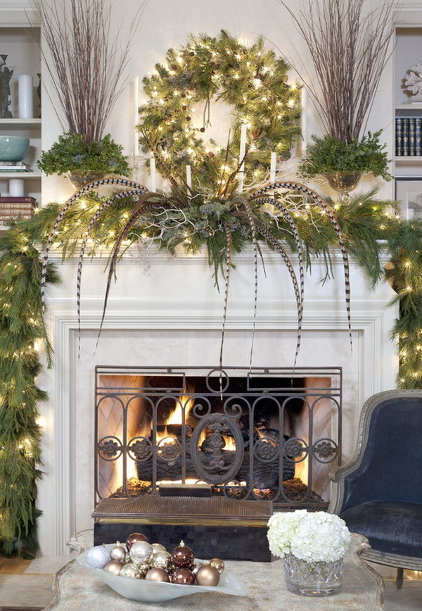 25  Gorgeous Christmas Mantel Decoration Ideas   Tutorials   Hative Hanging Green Christmas Wreath over White Wood Mantel with Green Leaves and  Long Feathers on the Mantel